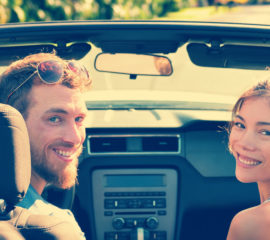 Car couple on summer holidays road trip travel vacation panoramic banner crop. Happy tourists driving convertible sports car on holiday, banner header crop.