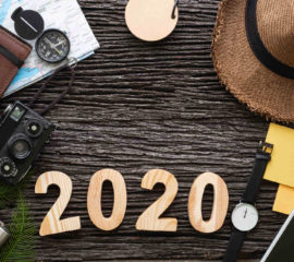 top view 2020 happy new year number on wood table with adventure accessory item,holiday vacation planning